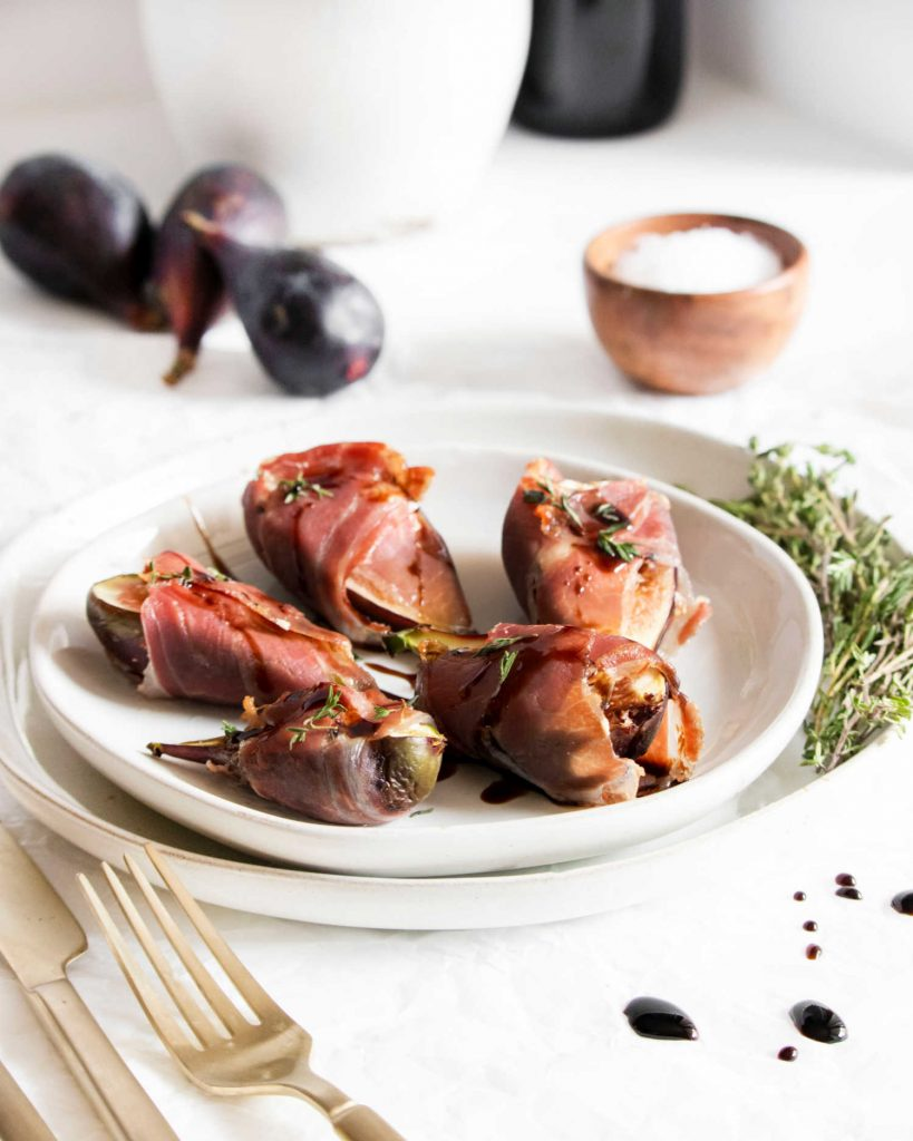 fig appetizers on a white plate