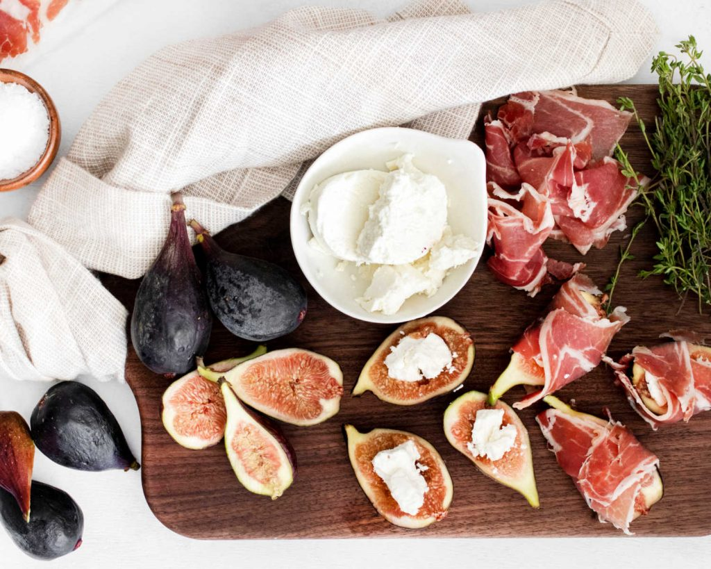 figs cut in half with goat cheese